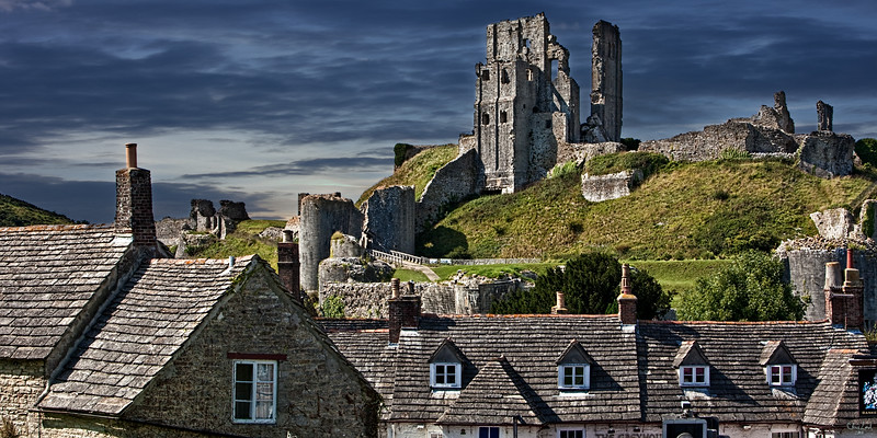 The Rooftops of Corfe In Dorset With The Castle As Backdrop
