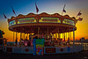 The Galloping Horses Carousel on Brighton Pier at Sunset