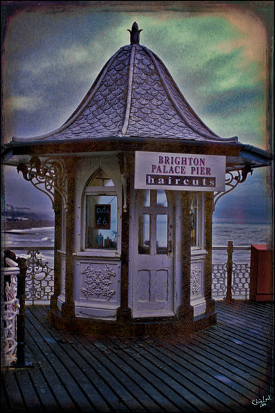 """Anyone for a Haircut? On the Palace Pier at Brighton.<br /> An """"oldie but goodie"""" from my 35 mm slide collection."""