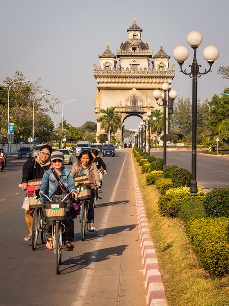 Bicyclers and the Patuxai, Vientiane