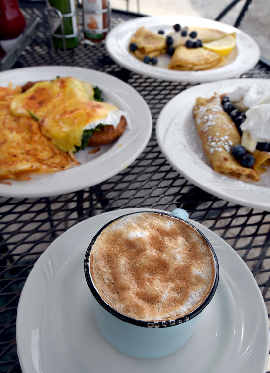. Cappuccino,  crab cake Florentine Benedict with hash browns, English pancakes, and fruit crepes at the Garden Gate Cafe in Niwot.  Cliff Grassmick / Staff Photographer/ April 4, 2018