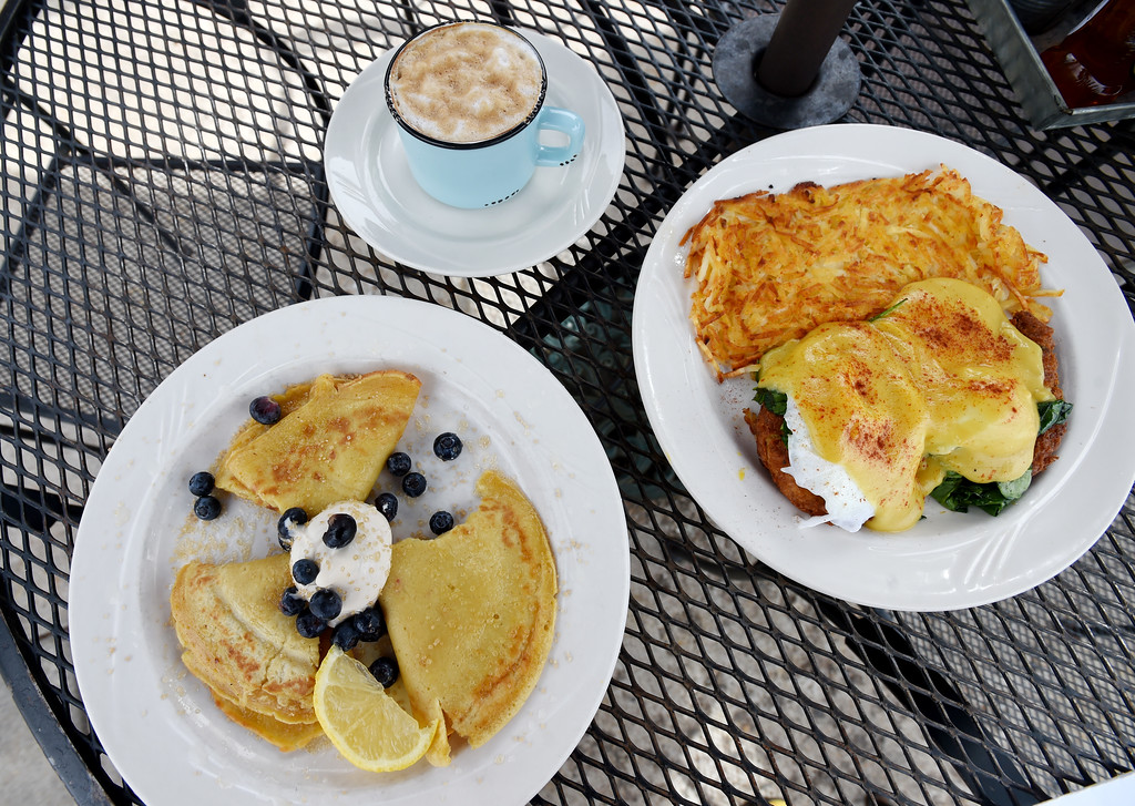 . English pancakes and  crab cake Florentine Benedict with hash browns at the Garden Gate Cafe in Niwot.  Cliff Grassmick / Staff Photographer/ April 4, 2018
