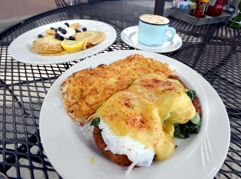 . English pancakes and  crab cake Florentine Benedict with hash browns, foreground, at the Garden Gate Cafe in Niwot.  Cliff Grassmick / Staff Photographer/ April 4, 2018