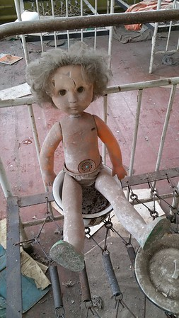 This doll never originally sat on that potty..occasionally Chernobyl gets invaded by Stalkers,explorers who visit illegally and they mess about with the remnants just to take more dramatic pictures.