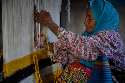 Amina spins the wool by hand, dyes it with natural colors including saffron, henna, and indigo, and then weaves it on this loom.  One rug can take six months to complete.