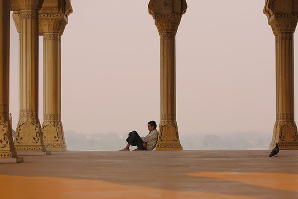 A man pauses for a reflective moment in the Taj Mahal, India
