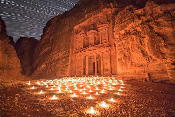 The Treasury in Petra, Jordan is an incredible site at night, when it is illuminated by candlelight. <br /> <br /> The star trails in the sky were composed of 120 individual exposures.