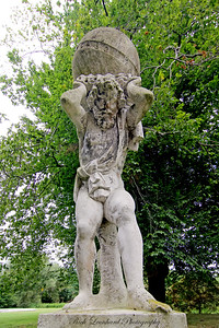 Statue of Atlas holding the world at Old Westbury Gardens.