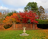 Sundial and Autumn foliage in the Walled Garden at Old Westbury Gardens.