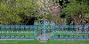 Beautiful blue and gold fence in Old Westbury gardens.