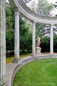 Colonnade with sculpture at Old Westbury Gardens.