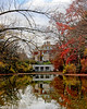 Westbury House in Old Westbury Gardens with Fall foliage and nice reflection.