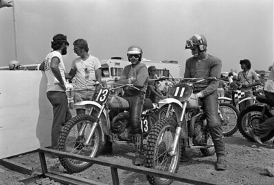 Starting gate at the 1973 Saint Louis, Missouri USA 125cc World Championship race with team Husqvarna European Riders - (13) Nile Arne Nilson; (11) Gibert DeRoover. Facing the camera in the white T-shirt is Husqvarna USA racer and team manager Gunnar Lindstom.