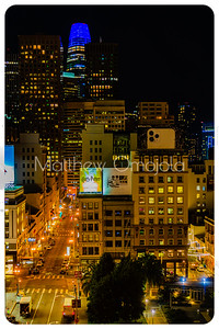 Night Scene San Francisco California skyline. Salesforce tower with moon on top. Post Street with stores. Union Square right foreground. Editorial photo.