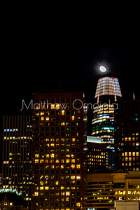 Night Scene SAn Francisco skyline. Close up Salesforce tower with moon on top of tower. .