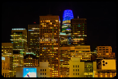 Night Scene San Francisco California skyline. Salesforce tower with blue glow on top. Editorial photo.
