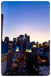 Daybreak blue hour San Francisco California skyline. Salesforce tower tallest building. Post Street with stores. Union Square right foreground. Editorial photo