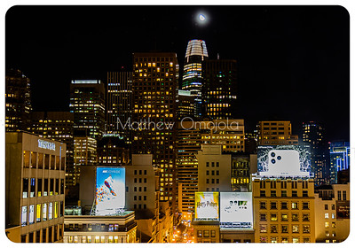 Night Scene San Francisco California skyline. Salesforce tower with moon on top.  Editorial photo.
