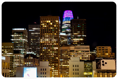 Night Scene San Francisco California skyline. Salesforce tower with pink blue glow on top