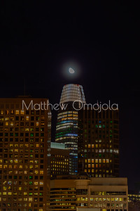 Night Scene SAn Francisco California skyline. Salesforce tower with moon on top.