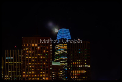 Close Up Night Scene San Francisco skyline. Salesforce tower Blue glow with moon.