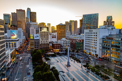 Daybreak golden hour San Francisco California skyline. Salesforce tower tallest building. Post Street with stores. Union Square, Macy's and Geary street right foreground. Editorial photo