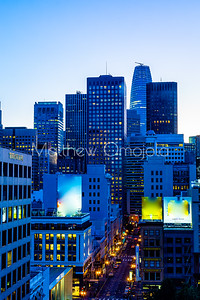 Night Scene daybreak blue hour San Francisco California skyline. Salesforce tower tallest building. Post Street with stores.