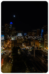 Night Scene San Francisco California skyline. Salesforce tower top with blue glow and  moon on top. Post Street with stores. Union Square right foreground at night .