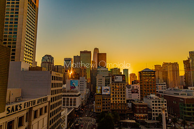 Daybreak golden hour San Francisco California skyline. Salesforce tower tallest building. Post Street with stores. Union Square and Geary street right foreground. Editorial photo.