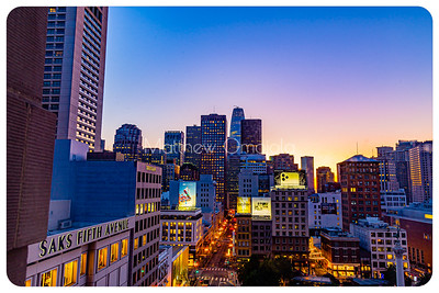 Night Scene daybreak blue hour San Francisco California skyline. Salesforce tower tallest building. Post Street with stores. Union Square right foreground. Editorial photo.