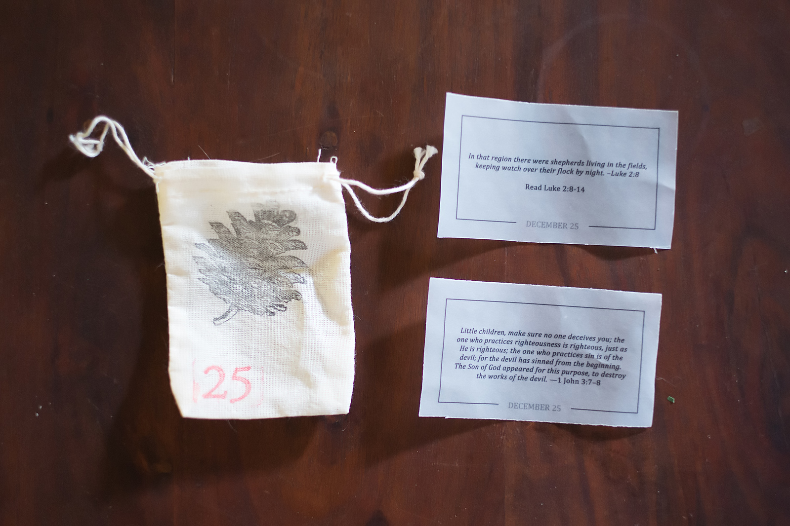 Number and greenery stamps create beautiful decorations on muslin bags. Verses printed on Vellum complete the bags