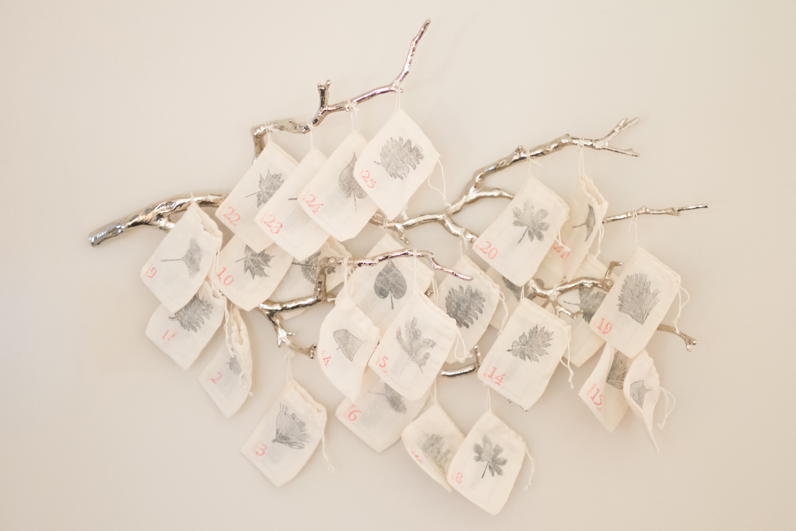 Number and greenery stamps create beautiful decorations on muslin bags