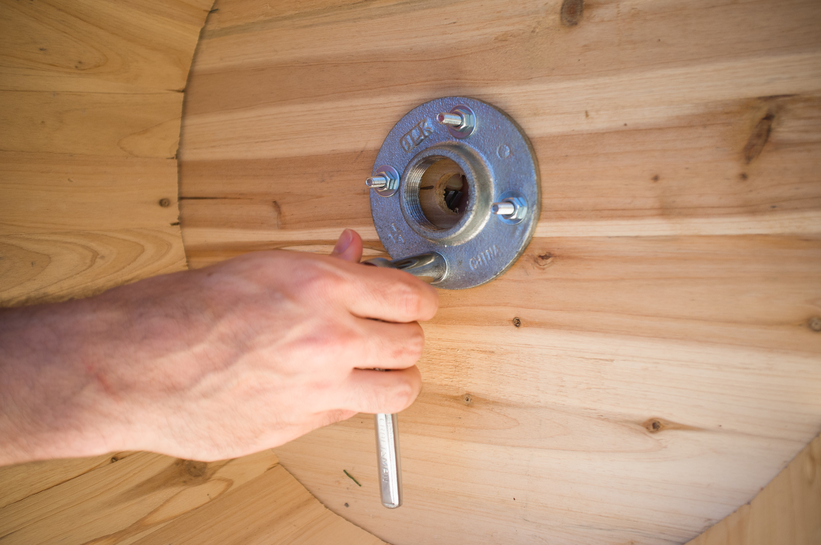 Use a socket wrench to tighten each nut