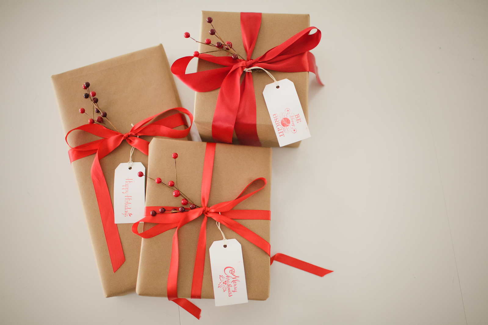 Kraft Paper with Red Ribbon and Berries