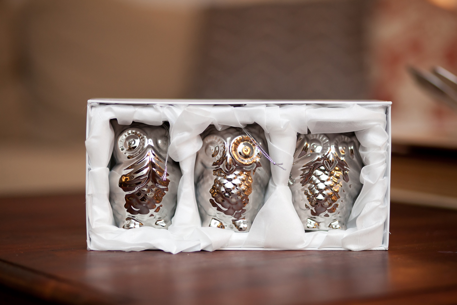 Three Wise Owls Ornaments in their packaging
