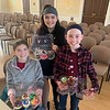 Showing off their outstanding cupcakes, from left, Brianna Cairns, Hayden Cairns and Kate Leonard, all of Chelmsford