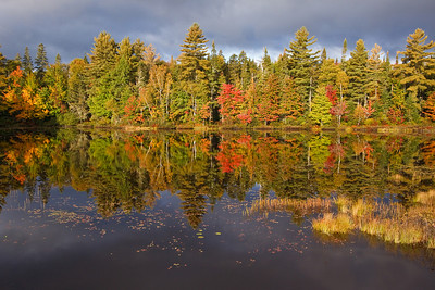 A clearing storm adds a dramatic effect to reflections on the Androscoggin River in northern New Hampshire.