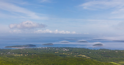Fogs cloaks the islands of Frenchman Bay, as seen from atop Cadillac Mountain -  Acadia National Park