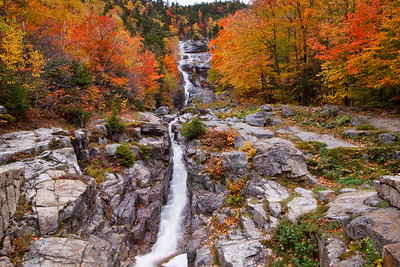 Silver Cascade in Crawford Notch State Park ablaze in Autumn colors