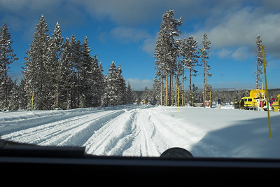 Riding shotgun on the snowcoach into Yellowstone.