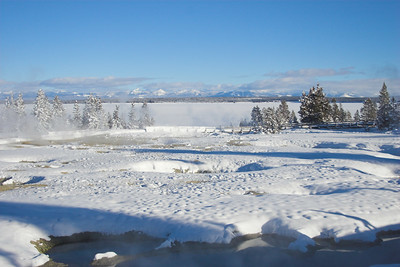 West Thumb Geyser Basin with Yellowstone Lake in the background.