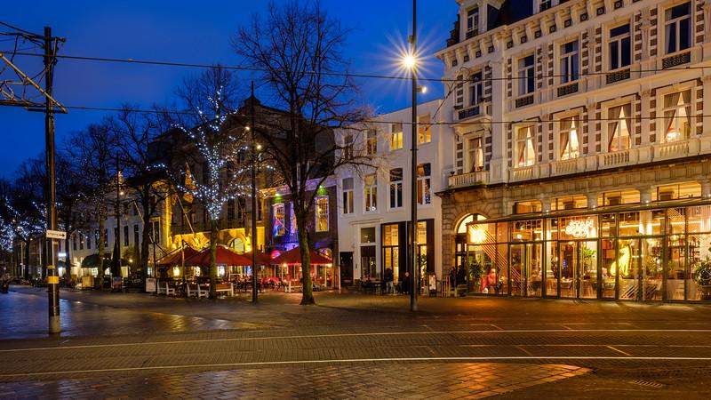 Cinema, Bars and Restaurants on the Buitenhof at dusk.