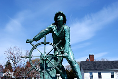 Man at the Wheel:  This is the Gloucester Fisherman's Memorial in Gloucester, MA.