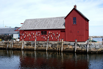 """Motif Number 1: This is a fishing shack in Rockport, MA known as one of the most painted buildings in America. The shack is called """"Motif Number 1"""" because it's the favorite subject of the town's painters from the artist colony where the shack is located. This is actually the 2nd of two shacks. The origianl shack (built in the 1840's) was destroyed during the Blizzard of 1978, but an exact duplicate was constructed later that same year."""