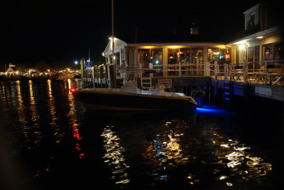 Jet Blue: A boat docked at Baxter's restaurant in Hyannis. It had these blue lights just below the water line which made it look like it had a pair of jets.
