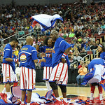 The Globetrotters took off their warmups in the middle of the floor.