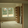 The music room opens to the family room with double pocket doors.  The two bookcases will both be inset on the right where one is now.