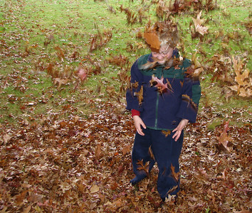 Playing in the leaves. October 28, 2006
