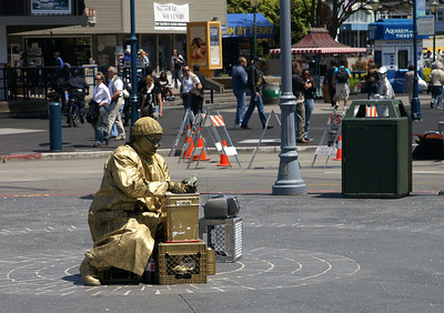 The gold man counting his green.