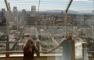 Our reflection and the view's reflection in the windows at the top of the Space Needle.